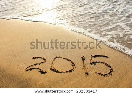 2015 year written on sandy beach #232381417