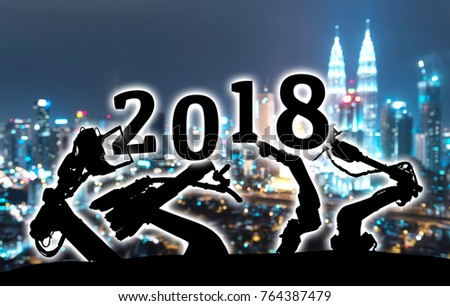 2018 years of ai technology , industry 4.0 , artificial intelligence trend concept. Silhouette of automation robot arms. Blur metropolis city building background. #764387479
