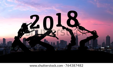 2018 years of ai technology , industry 4.0 , artificial intelligence trend concept. Silhouette of automation robot arms. Blur metropolis city building background. #764387482