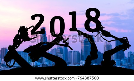 2018 years of ai technology , industry 4.0 , artificial intelligence trend concept. Silhouette of automation robot arms. Blur metropolis city building background. #764387500