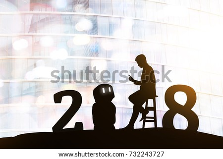 2018 years of robot assistant technology , industry 4.0 , artificial intelligence trend concept. Silhouette of business man talking to automation robo advisor. Bokeh flare light effect background.