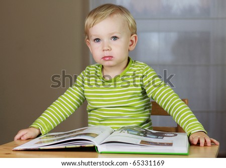 2 years old baby boy reading book