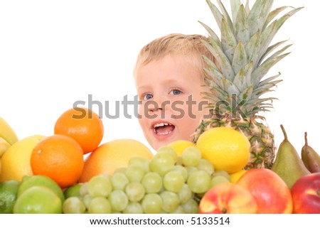 3-4 years old boy and lots of various fruits isolated on white