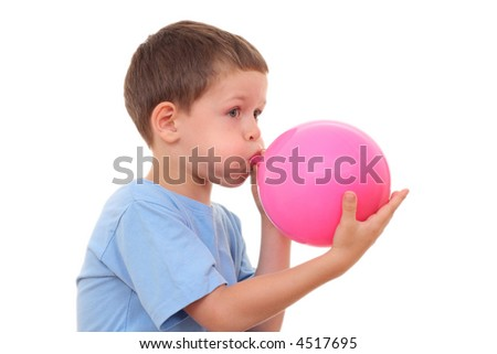 5-6 years old boy blowing up balloon isolated on white