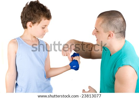 8 years old boy doing fitness with his father as a coach