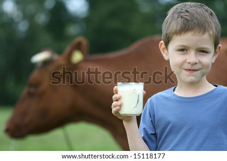 6-7 years old boy drinking milk on farm