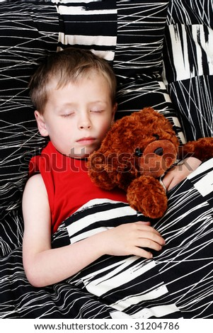 4-5 years old boy in bed - sleeping time