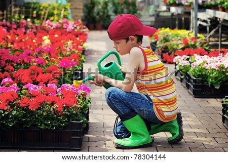 9 years old boy in his flower garden - kids and family