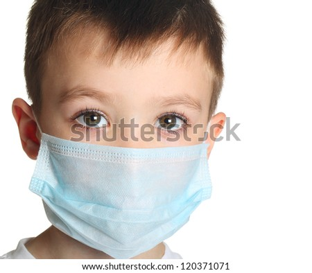 5 years old boy in medicine healthcare mask isolated on white background