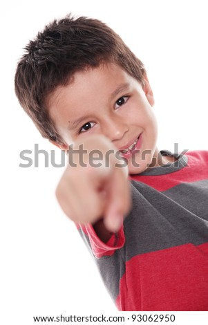 7 years old boy looking and pointing the camera