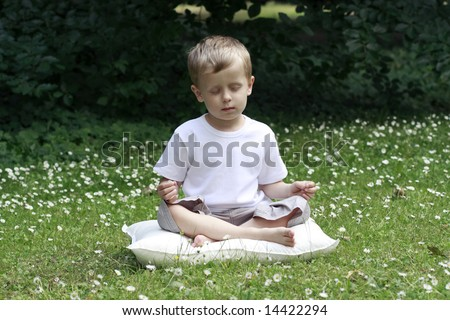 4-5 years old boy meditating outdoor