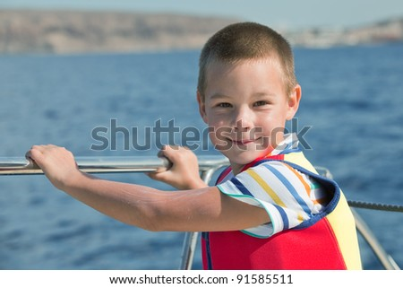 6 years old boy on a sailing boat
