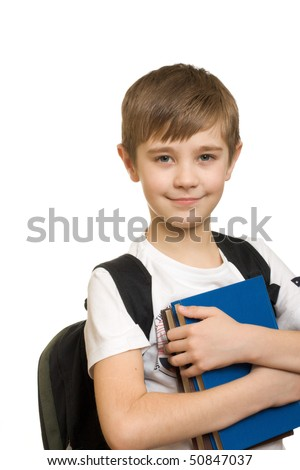 10 years old boy with a backpack isolated on white background Stockfoto ©