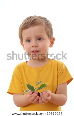 4-5 years old boy with green plant isolated on white
