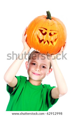 8 years old boy with Halloween pumpkin on white background - family and kids