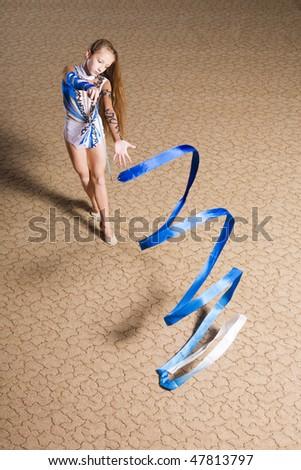 12 years old girl doing rhythmic gymnastics