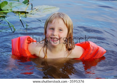 5 years old girl swimming