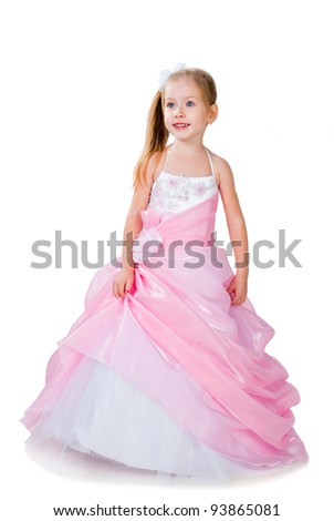4-6 years old girl wearing gorgeous gown isolated on white studio background