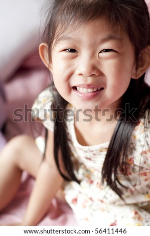 5 years old happy Asian girl smiling