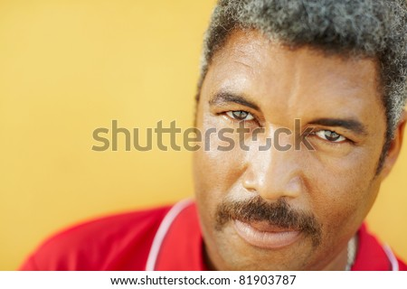 50 years old latin american man looking at camera with intense stare. Head and shoulders, copy space