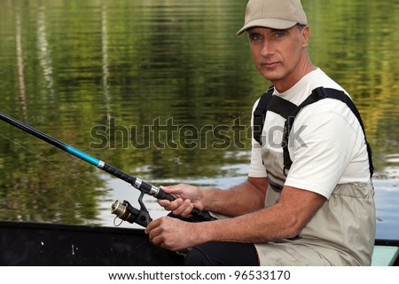 45 years old man on a boat and fishing