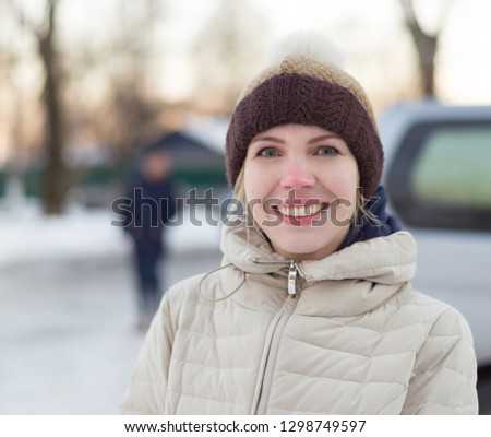 38 Years Old Woman In A Hat With A Pompon In Winter 1298749597
