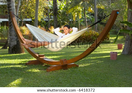 20-25 years woman portrait relaxing on hammock at exotic surrounding, bali indonesia - stock photo