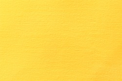 Yellow canvas background. Surface of fabric texture in autumn leaves color.