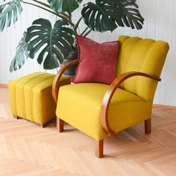 Yellow upholstered chair. Armchair from sixties. Czechoslovakia furniture desing. Restored furniture, yellow fabric. Design interior.