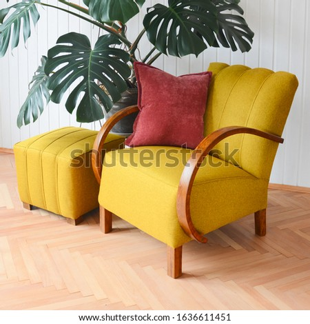 Yellow upholstered chair. Armchair from sixties. Czechoslovakia furniture desing. Restored furniture, yellow fabric. Design interior.  Foto d'archivio ©