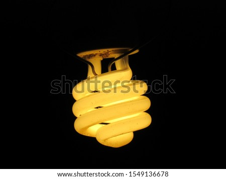 Yellowish fluorescent light on any given night