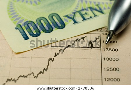 1000 Yen banknote with pen and rising stock chart.