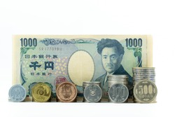 1,000 Yen Japan's banknote and coin on white background select focus at banknote