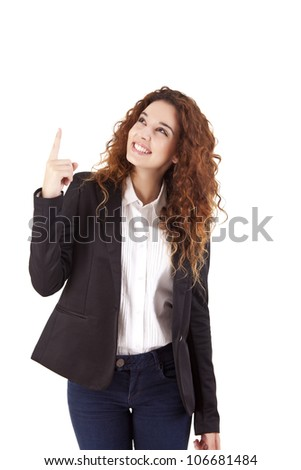 Young beautiful female business executive pointing at copyspace