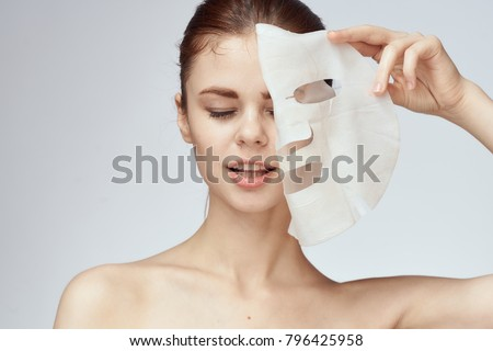 young beautiful woman in a face mask, skin care                              #796425958