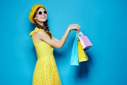 young beautiful woman on blue background with shopping, shopping