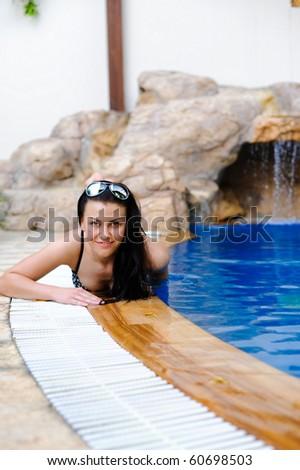 young beautiful woman swims in pool - stock photo
