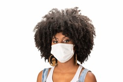 young black woman wears a protective mask against covid-19 coronavirus wearing a mask to contain contamination