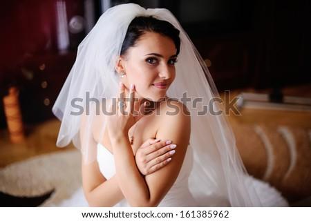 Young brunette bride in the morning at home.  Adorable fiancee.