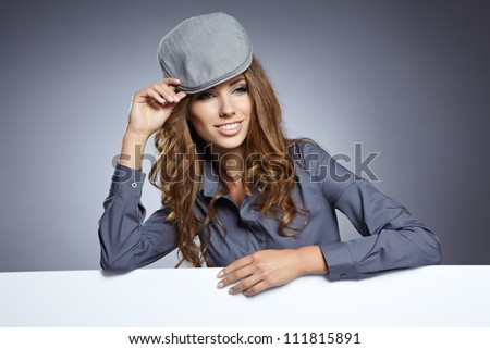 young business woman showing blank signboard, isolated over grey  background