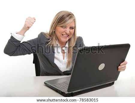 Young business woman with an annoyed expression raising her fist to computer