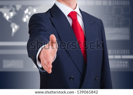 young businessman offering to shake hands against an high-tech interface. Clipping path included