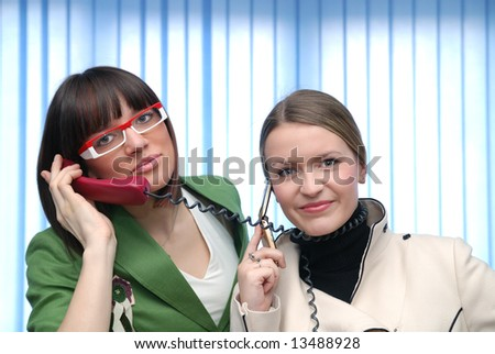 .young businesswomans talking by phone - stock photo