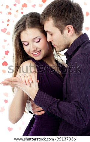 young couple dancing on white background with hearts