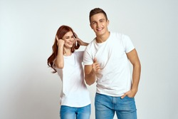 young couple laughing in white t-shirts