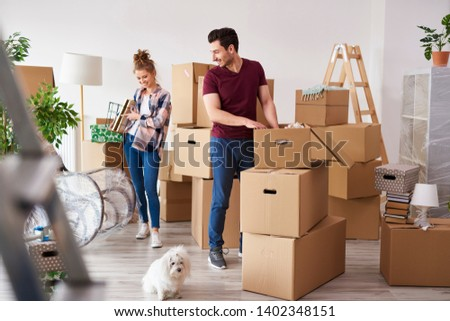 Young couple packing their stuff into boxes  #1402348151
