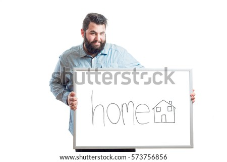 Young fat man holding a blackboard with the word house and a drawing of a house isolated on white background