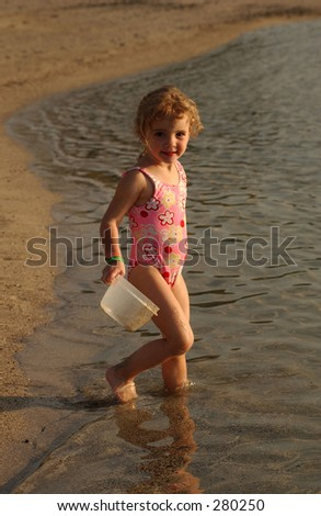 """Young girl on the beach holding a bucket, Big Island, Hawaii, (Keith Levit)"""