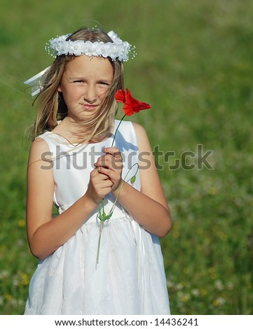 young girl ready for first holy communion