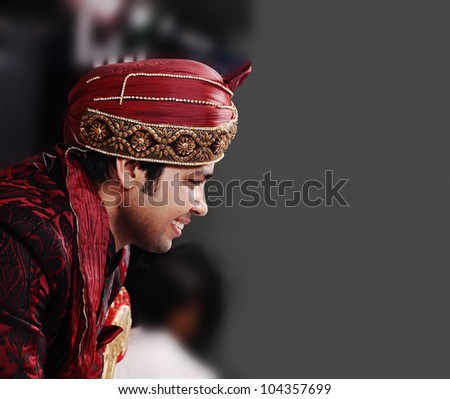 young   indian groom in a traditional clothing